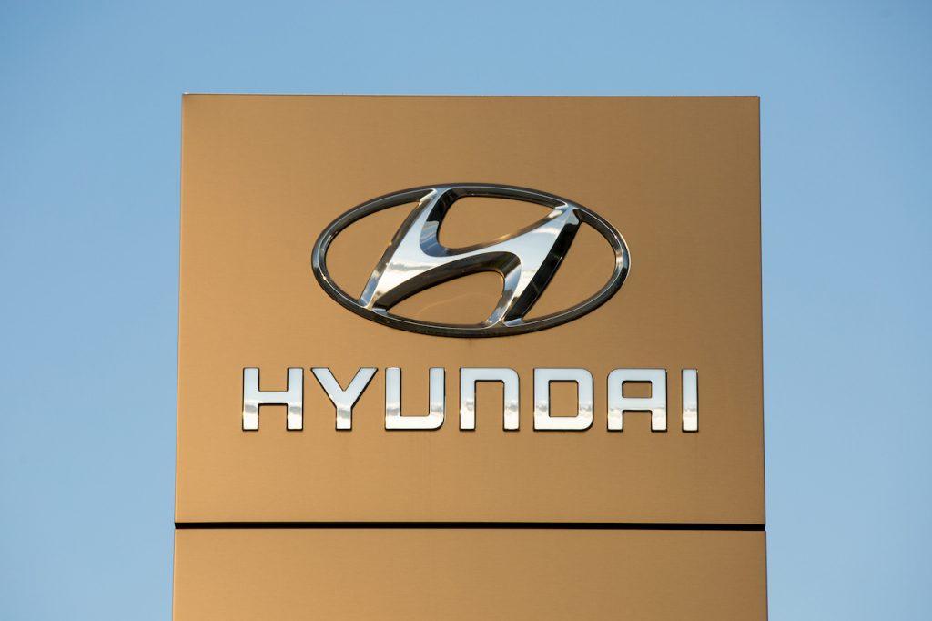 A close up image of the Hyundai logo.