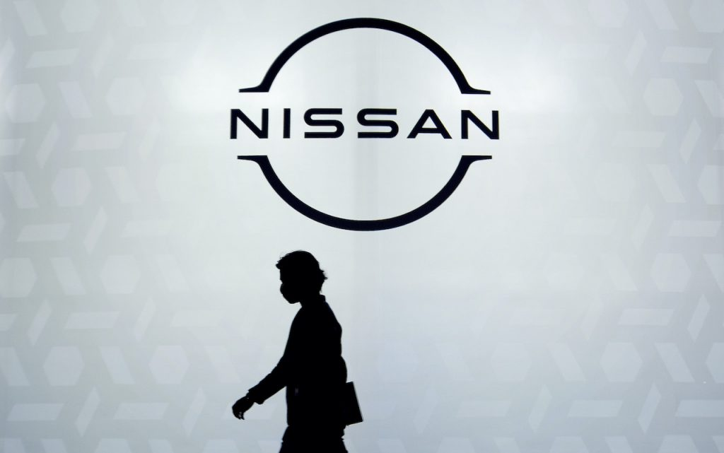 A close up image of the Nissan logo.