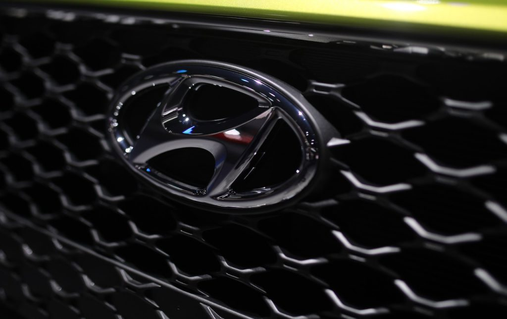 A close up image of the Hyundai logo.