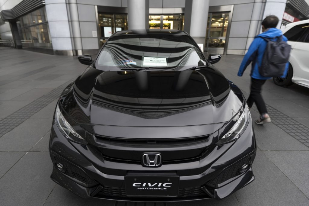 A black Honda Civic hatchback on display