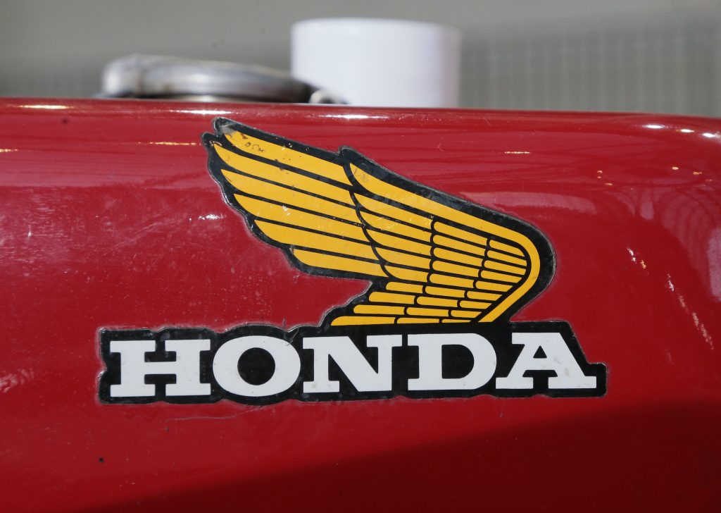 he brand on the reservoir of a 1960's Honda motorcycle