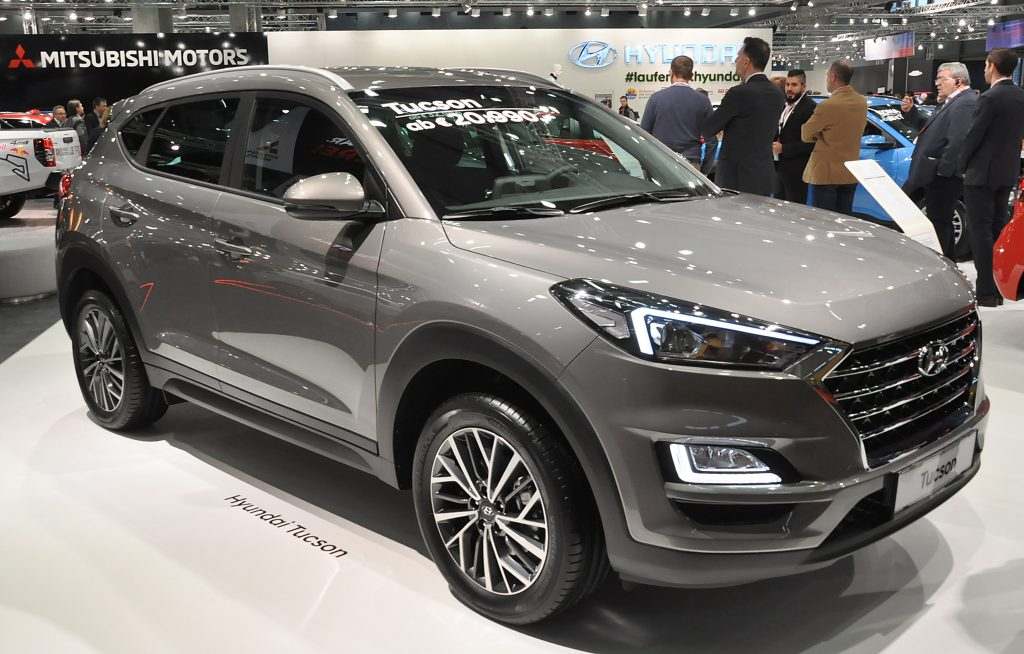 A Hyundai Tucson compact SUV on display at an auto show