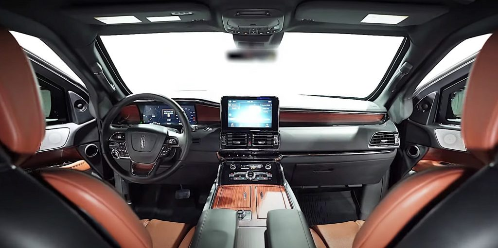 The two-tone brown/black interior of an armored 2020 Lincoln Navigator L