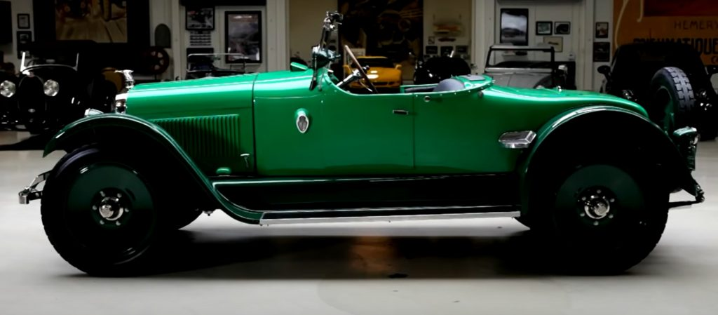 The side view of Jay Leno's restored green 1922 Wills Sainte Claire roadster