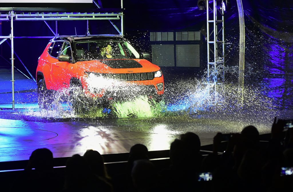 The 2017 Jeep Compass puts its capability on display by driving into water