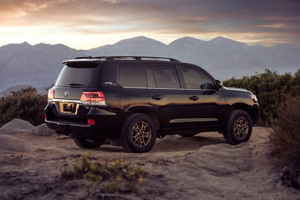 2021 Toyota Land Cruiser in the mountains demonstrates a capable SUV with an available third-row option