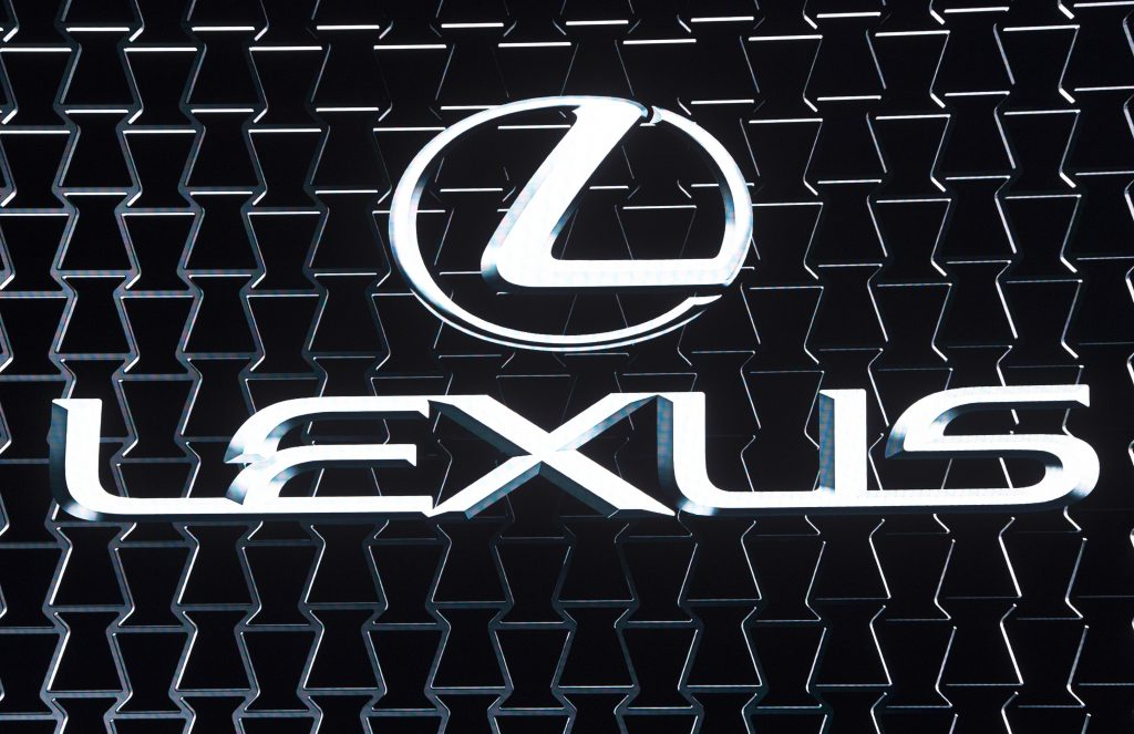 The Lexus logo on display at an auto show