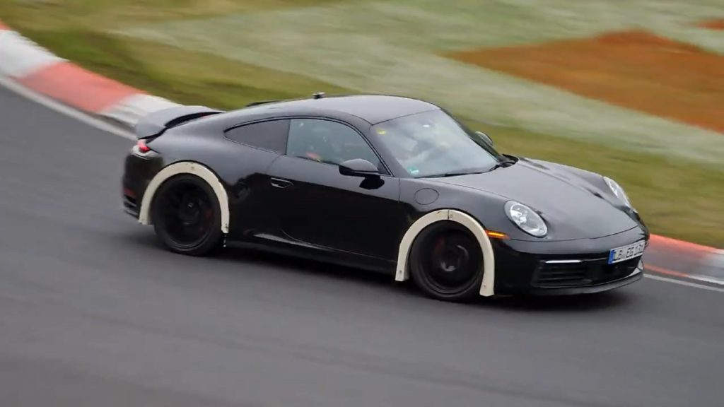A black lifted Porsche 911 test mule on the Nurburgring