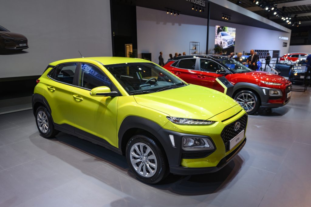 A green Hyundai Kona on display at an auto show