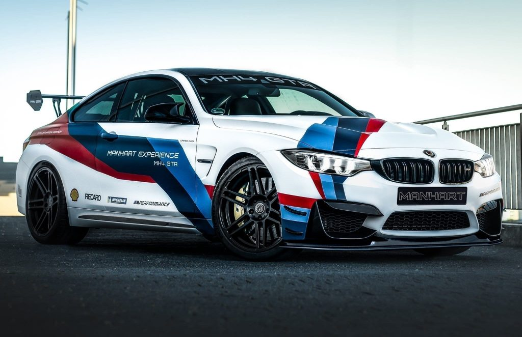 A white with red-and-blue-stripes Manhart MH4 GTR
