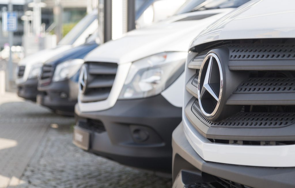 Mercedes-Benz Sprinter vans on display at a dealership