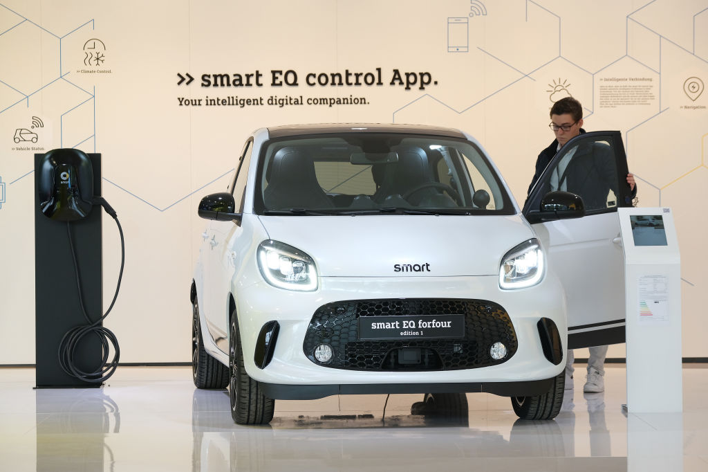FRANKFURT AM MAIN, GERMANY - SEPTEMBER 09: A visitor look at the Smart EQ forfour Edition 1 electric car at the Mercedes-Benz media preview at the 2019 IAA Frankfurt Auto Show on September 09, 2019 in Frankfurt am Main, Germany. The IAA will be open to the public from September 12 through 22. (Photo by Sean Gallup/Getty Images)