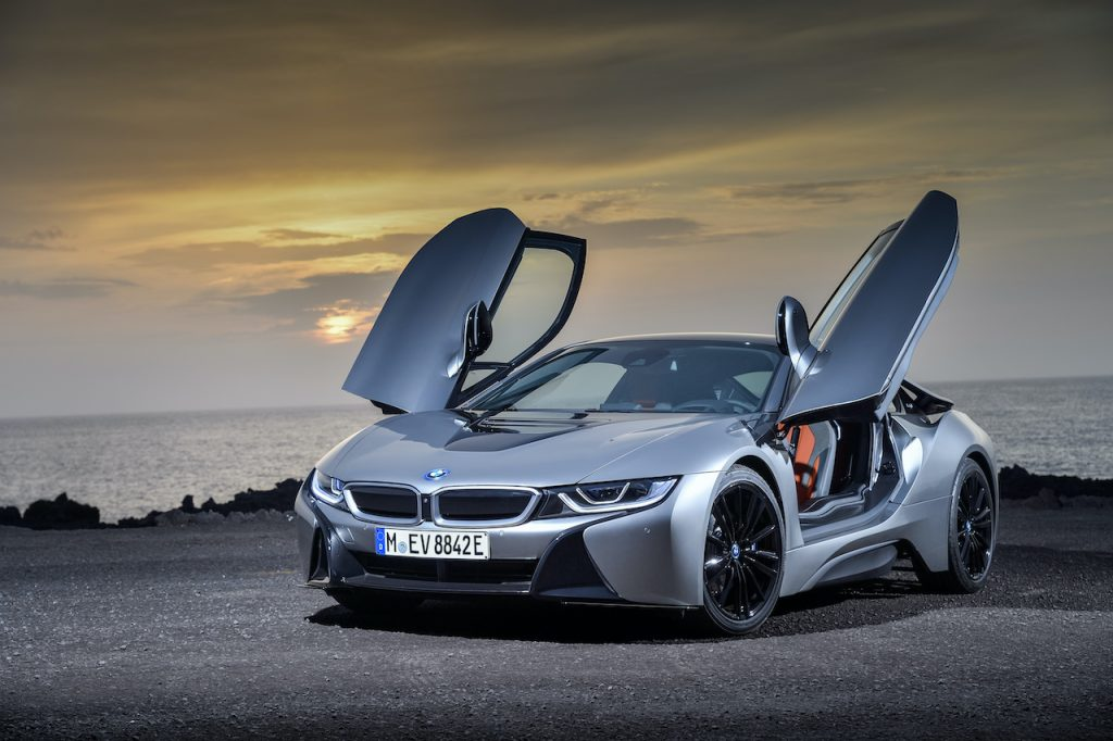 An image of a BMW i8 parked outside on display.