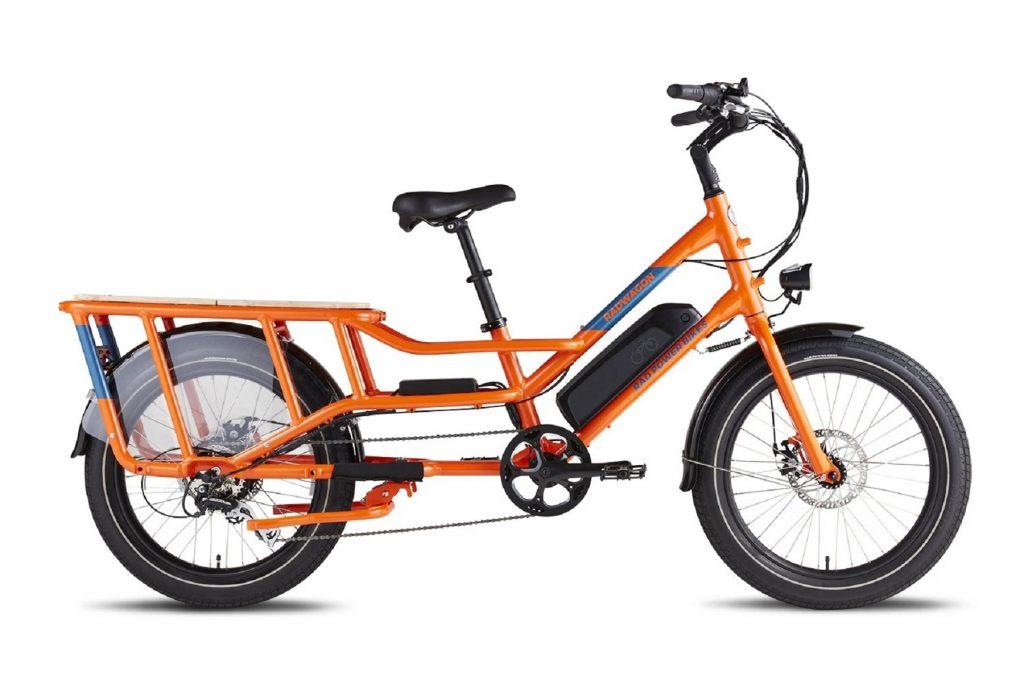 The side view of an orange Rad Power RadWagon4 e-cargo-bike