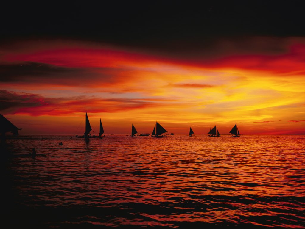 Boat silhouettes at sunset.