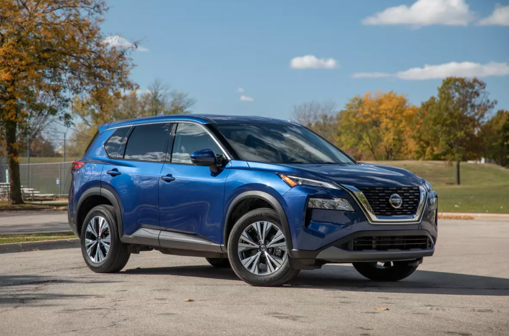 A blue 2021 Nissan Rogue parked on the track.