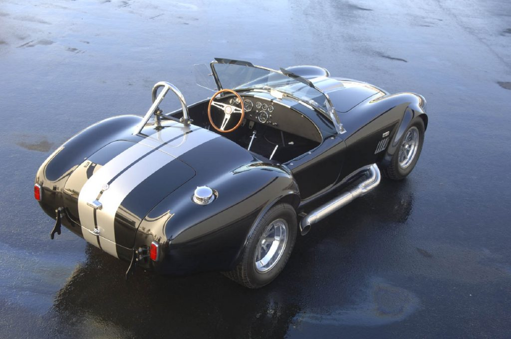 The rear overhead view of a dark-blue-with-white-stripes Shelby Cobra 427 S/C CSX-Series 6000 continuation