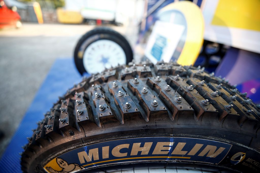 A studded snow tire from Michelin is waiting to be used on a rally car during the next maintenance stop.