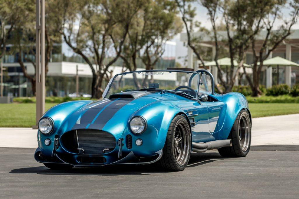 A turquoise Superformance MKIII-R Shelby Cobra replica kit car