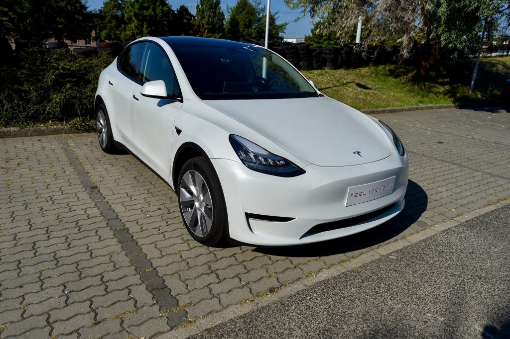"""A picture taken on September 5, 2020 shows a """"Tesla Model Y"""" car, an all-electric compact SUV by US electric car giant Tesla, during its presentation at the Automobile Club"""