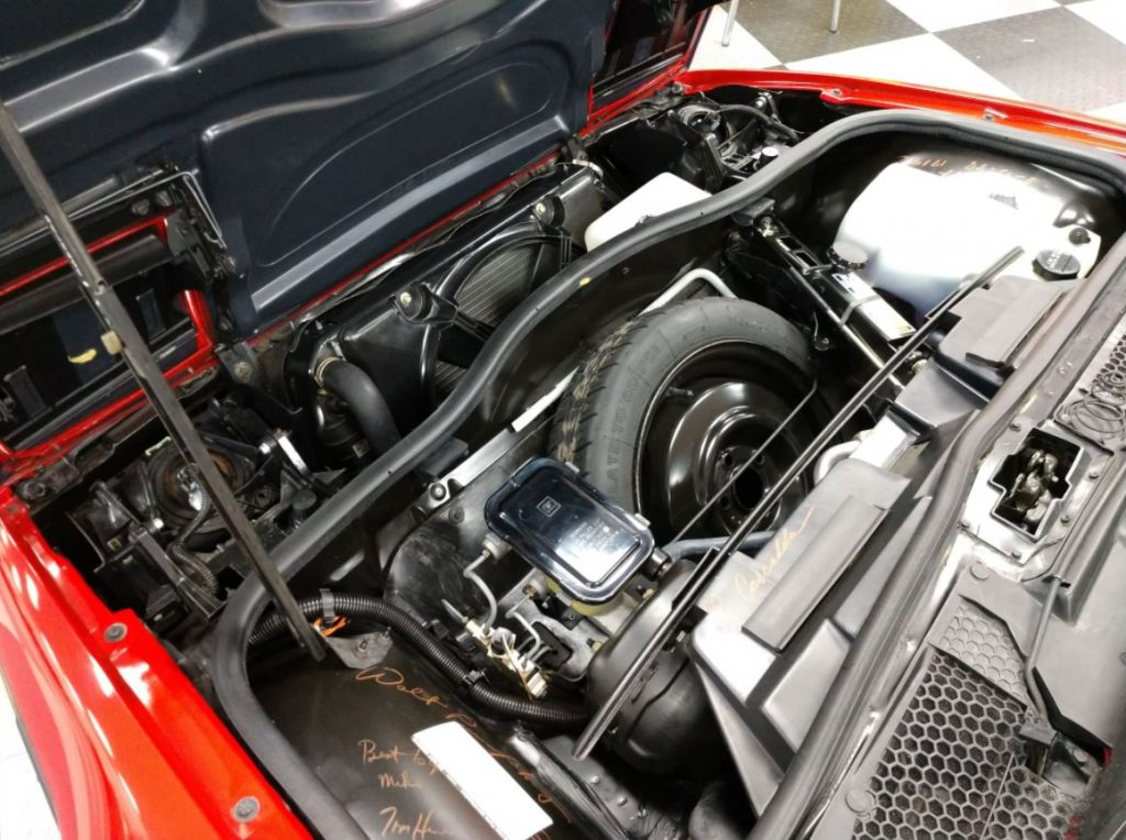 The immaculate engine bay of the 1988 Pontiac Fiero GT