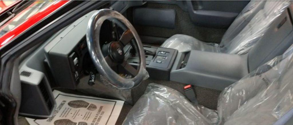 The grey interior of the last Pontiac Fiero ever produced.