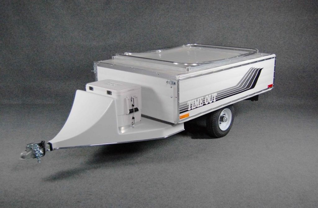 A white Time Out motorcycle camper RV trailer