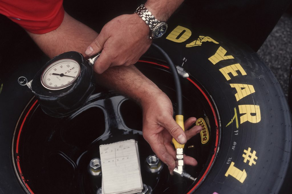 A tire gauge is being used to check pressure.