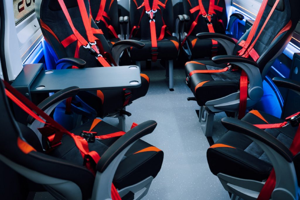 The Torsus Terrastorm's swiveling seats with 5-point harnesses and a table