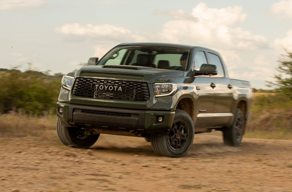 An army green Toyota Tundra off-roading