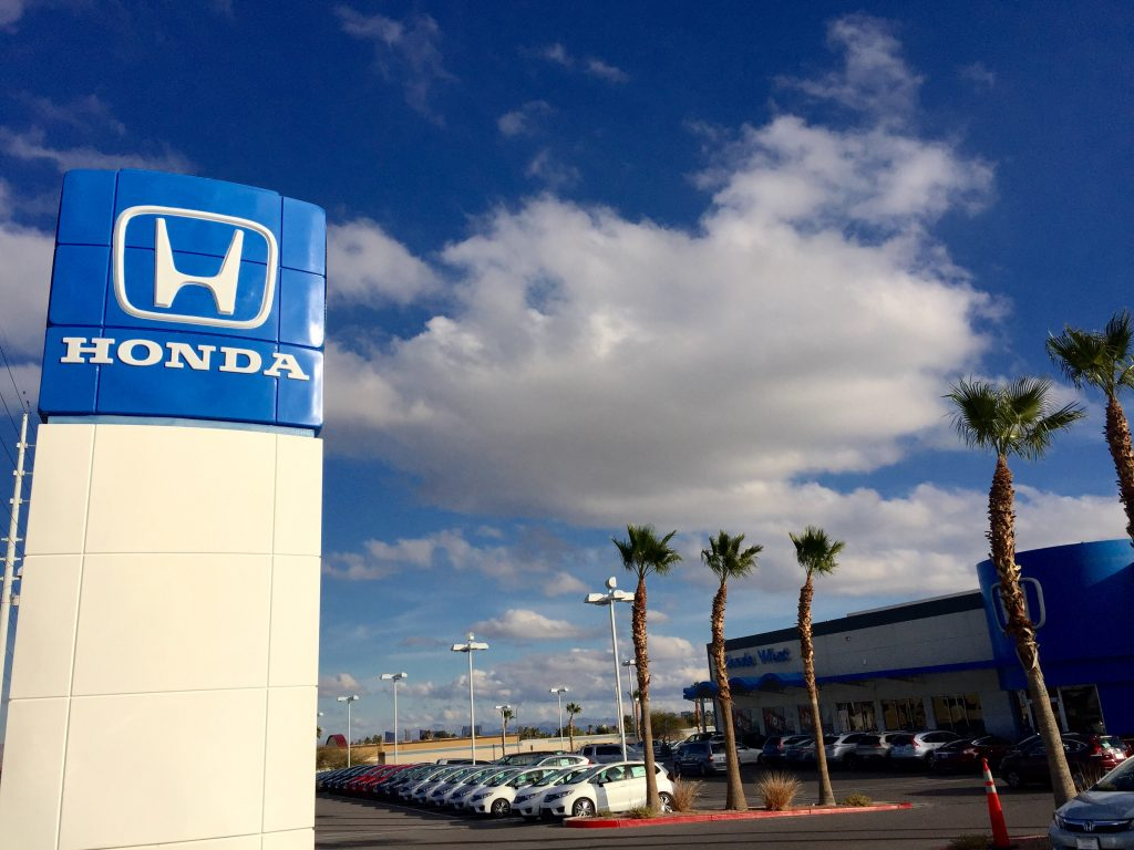 A used Honda car dealership with cars on display