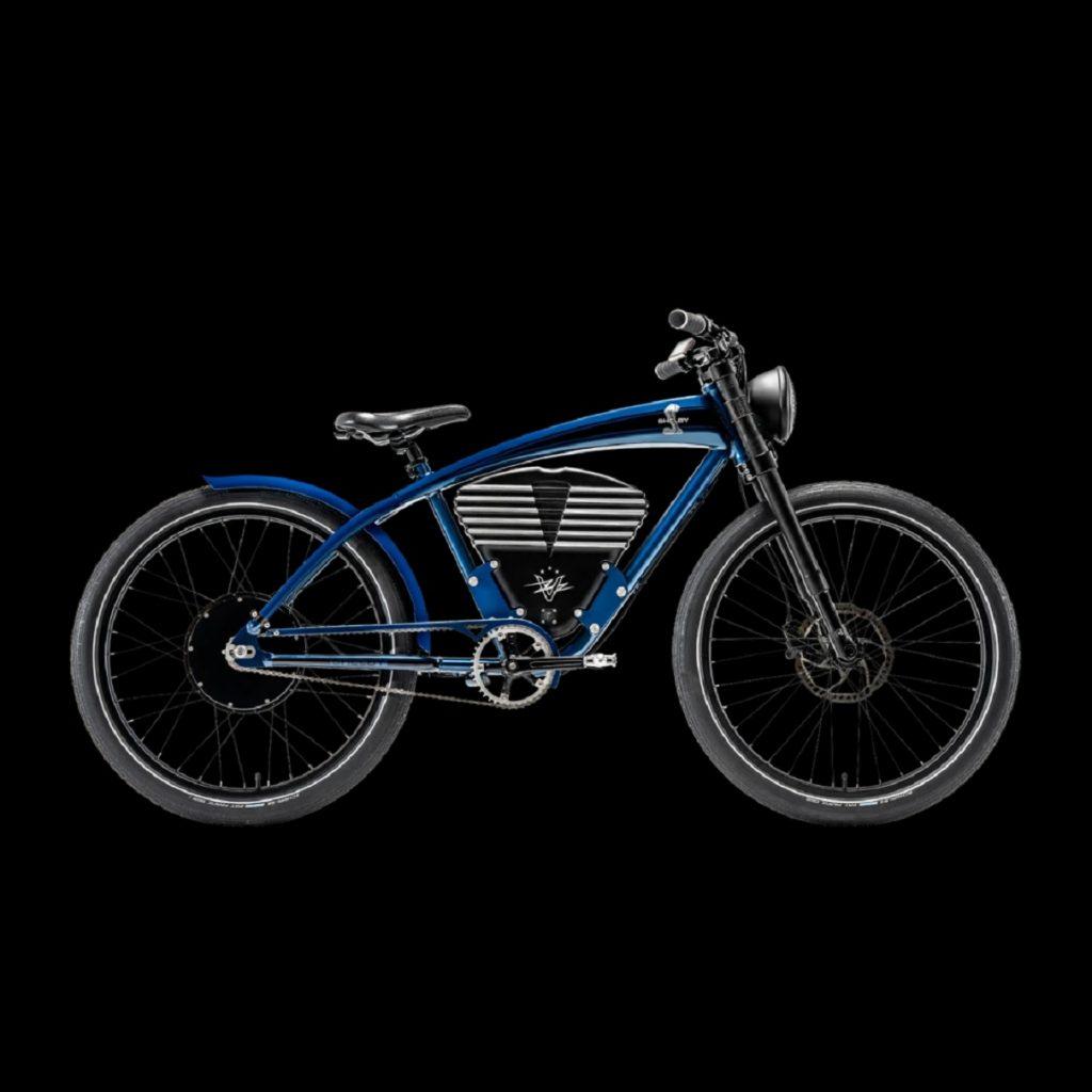 A blue Vintage Electric Shelby e-bike with the Shelby snake logo