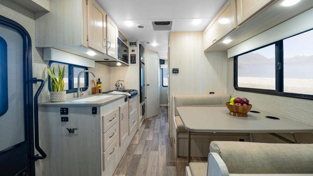 The bright open kitchen area inside a  Winnebago Outlook.