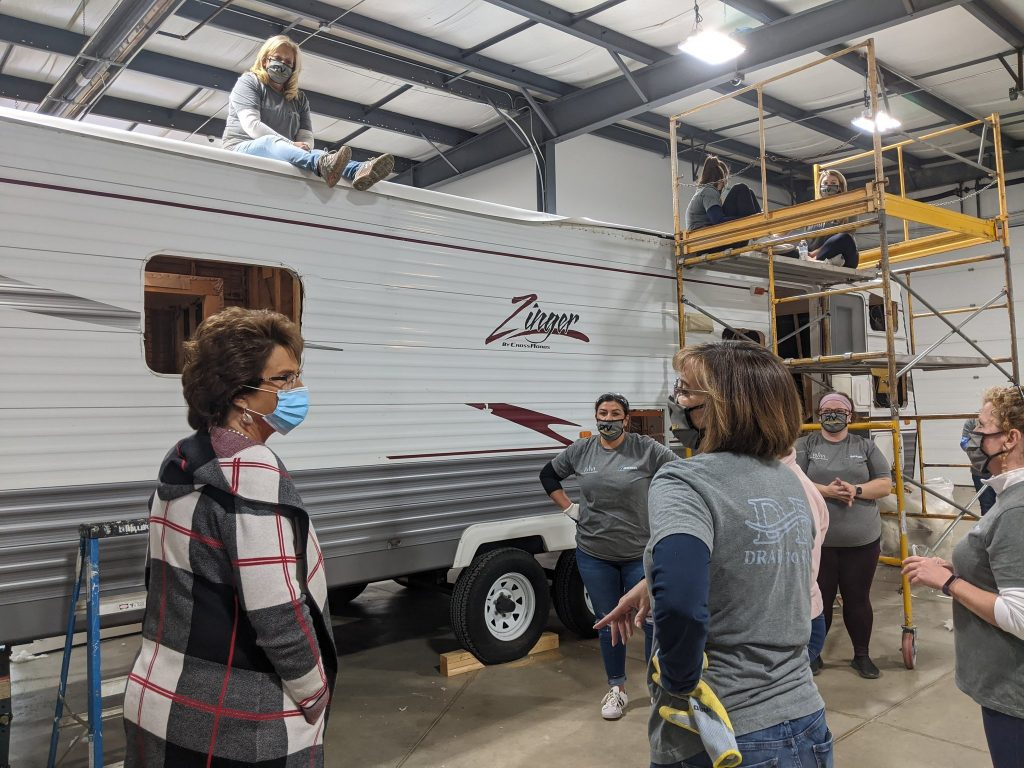A Zinger Crossroads travel trailer RV is being renovated by a team of women working on the Drab-to-Fab program