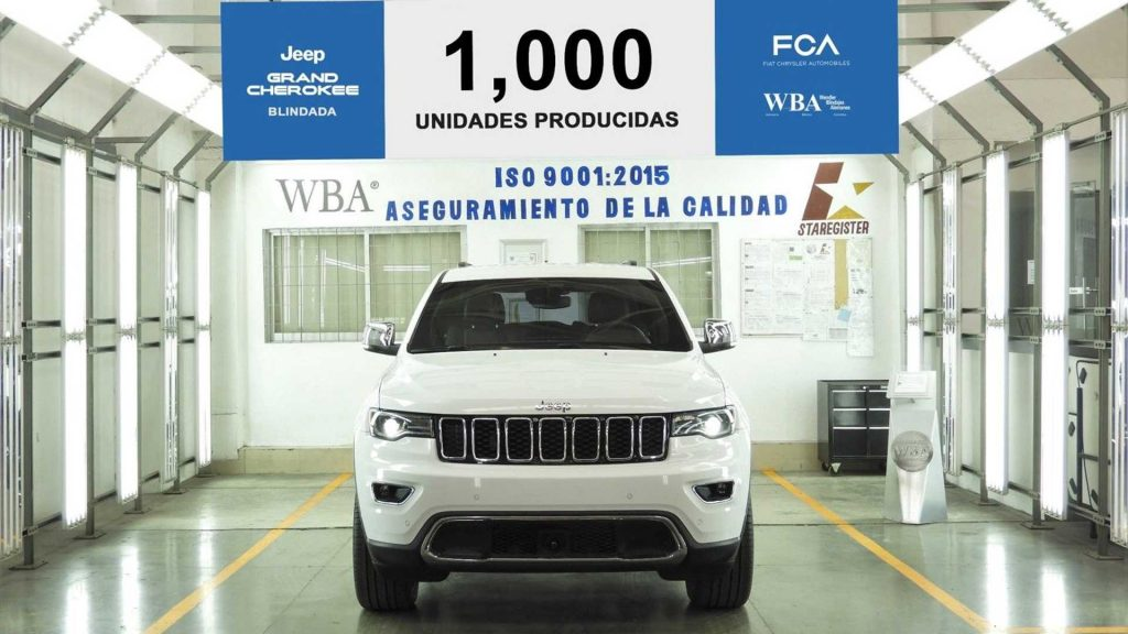The 1,000th completed armored Jeep Grand Cherokee sits on a factory floor.