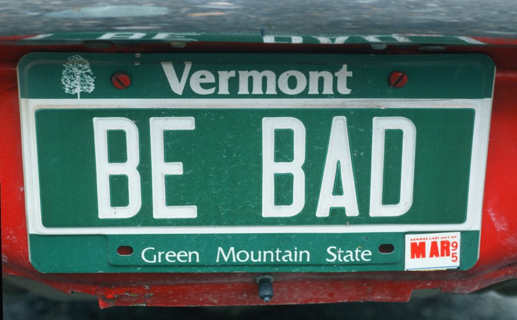 "A vermont license plate that says ""be bad"""
