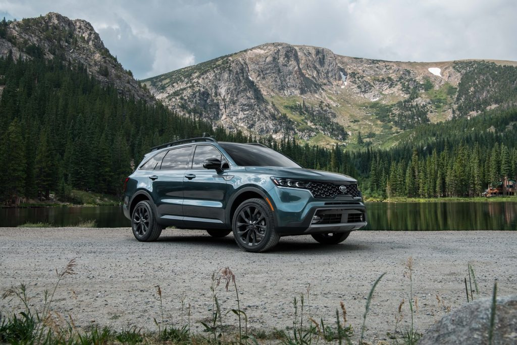 a 2021 X-line package dressed for rugged adventure parked by a lake in the mountains