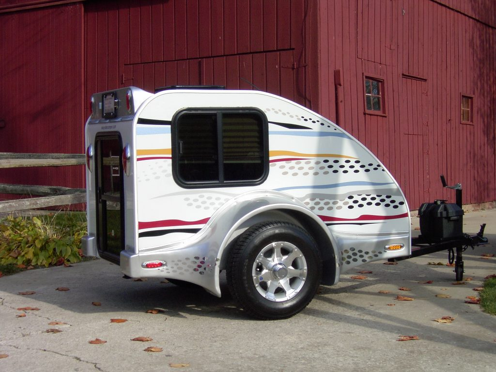 A white Easy Rider motorcycle camper RV trailer for motorcycles