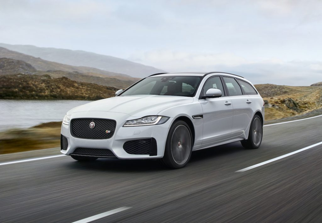 An image of a Jaguar XF driving down the road.