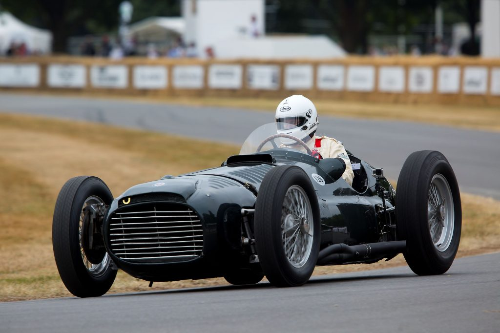 A black 1950 BRM Type 15 driven at Goodwood by Doug Hill