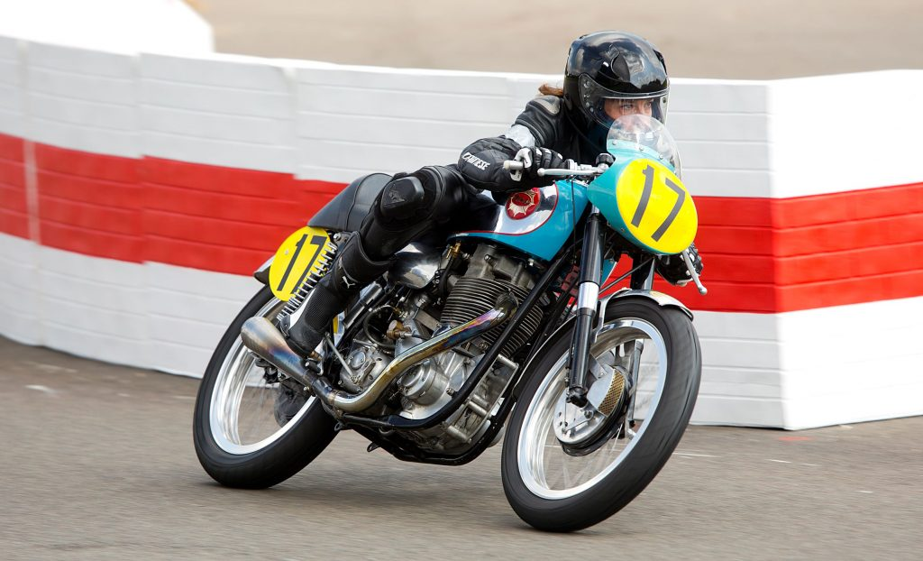 Sophie Smith on a teal 1954 BSA Gold Star racer