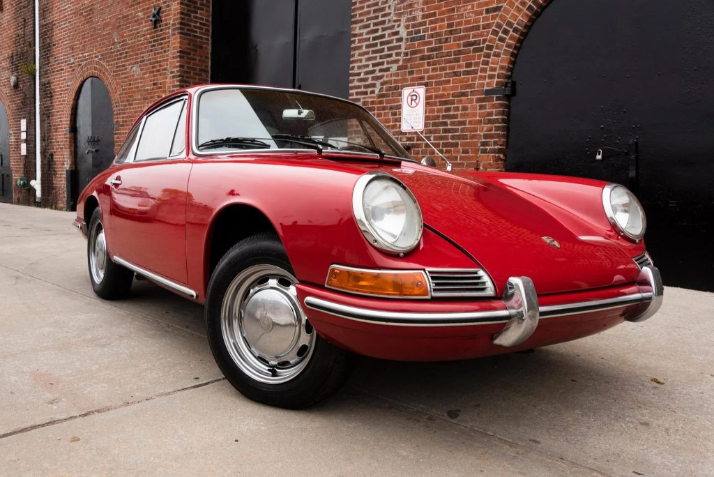 The front 3/4 of a red 1966 Porsche 912