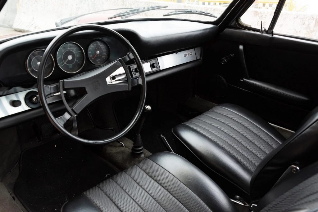 The black front seats and dashboard of a 1966 Porsche 912