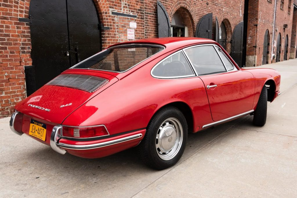 The rear 3/4 view of a red 1966 Porsche 912