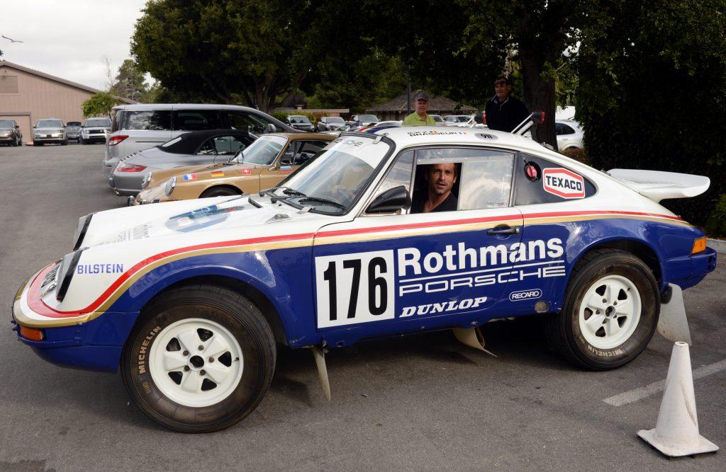 A blue and white 1984 Porsche 911 Paris Dakar Rally Car