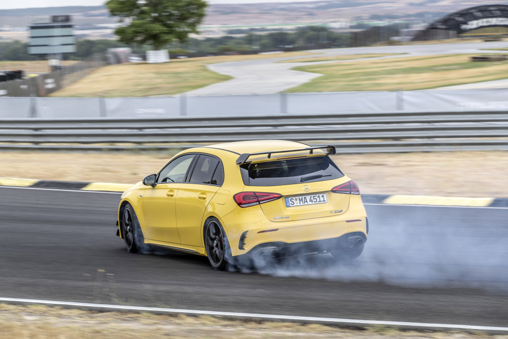 A photo of the Mercedes-AMG A 45 S utilizing its drift mode on track.