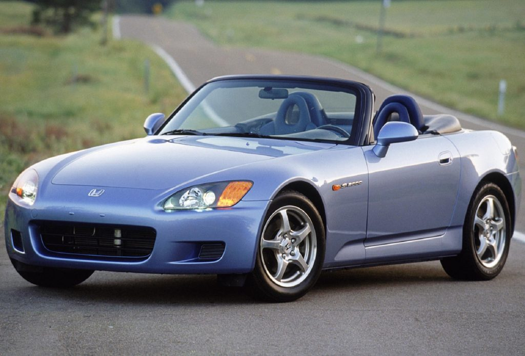 A blue 2002 Honda S2000 on a back-country road