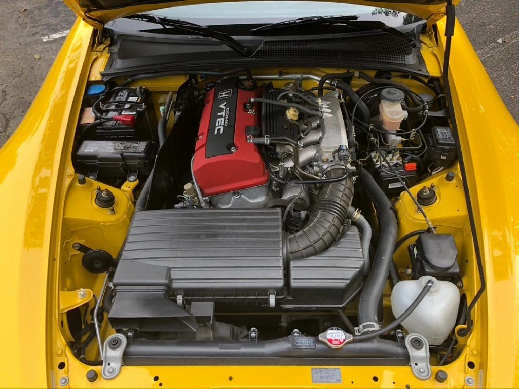 The red-covered 2002 Honda S2000's engine