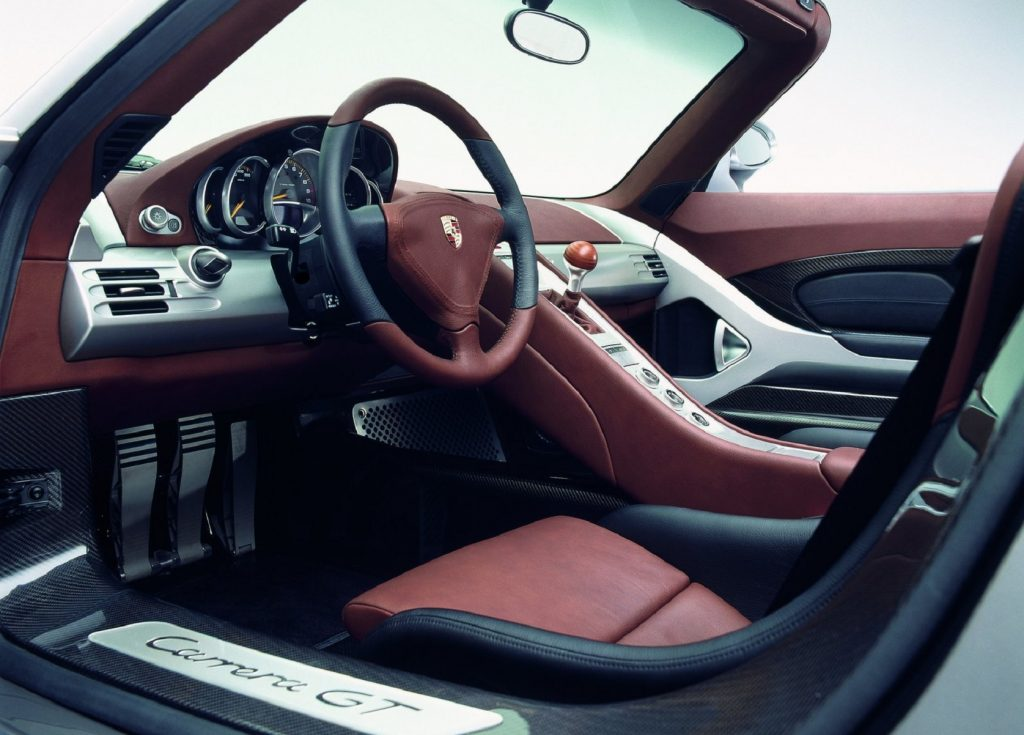 The 2004 Porsche Carrera GT's red-leather front seats and dashboard