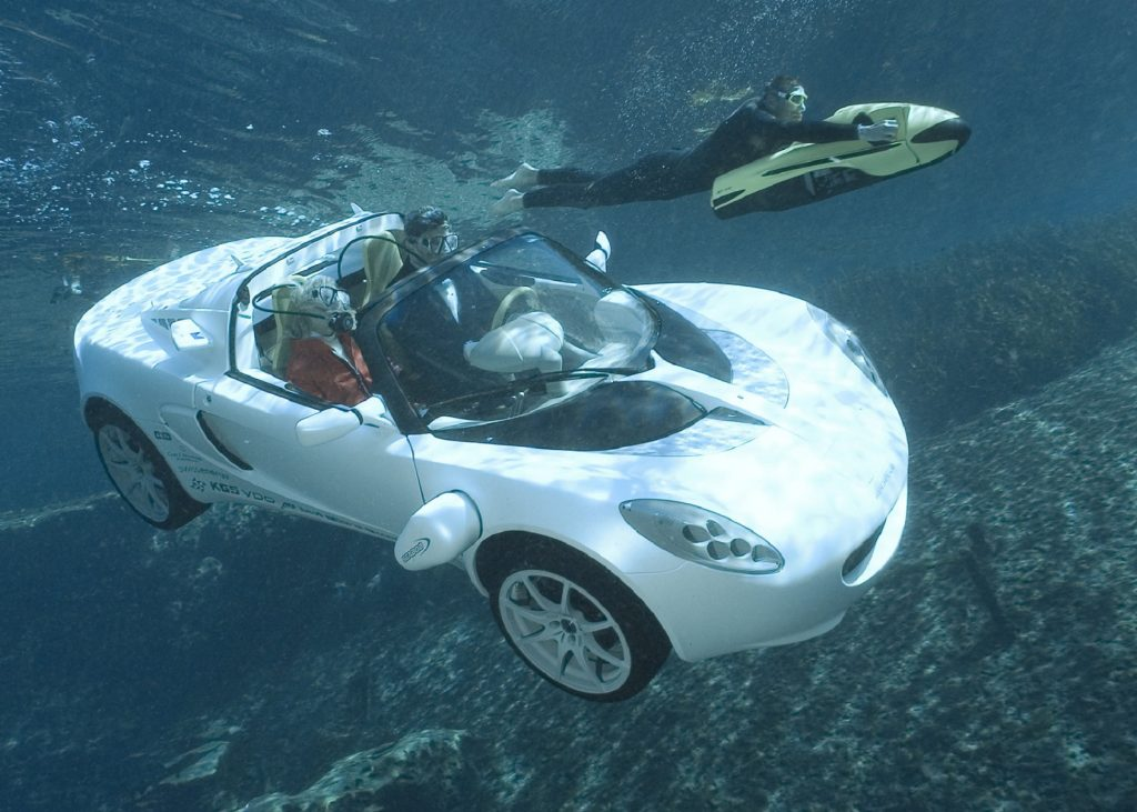 The white 2008 Rinspeed sQuba Concept floats through the ocean with a diver